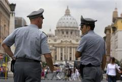 FILE - This Sept. 21, 2010 file photo shows Italian financial Police officers talking to each other with St. Peter's Basilica at the Vatican in the background, in Rome. On Thursday, Dec. 30, 2010 the Vatican created a new financial watchdog agency and issued new laws to comply with international rules fighting money laundering and terrorist financing. The decrees were passed as Vatican's own bank remains implicated in a money-laundering investigation that resulted in 23 million euro ($31 million) being seized and its top two officials under investigation. (AP Photo/Angelo Carconi, File)